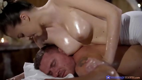 Two of the lesbians start to kiss each other while the third watches and plays with her pussy. The third chick is turned on by the action, and it&